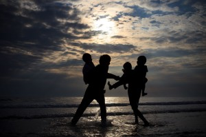 14658854 - children playing on sea beach in the evening lignt